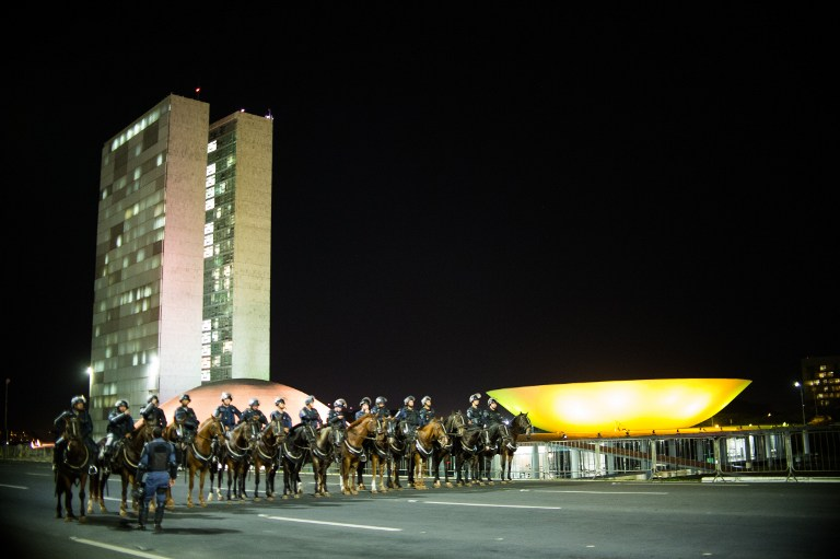 TIGHT SECURITY. Mounted police stand guard outside the National Congress in Brasilia on May 11, 2016, after a turmoil caused by demonstrators. Photo by Andressa Anholete/AFP