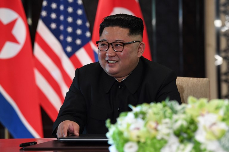 'DENUCLEARIZATION.' North Korea's leader Kim Jong Un reacts at a signing ceremony with US President Donald Trump (not pictured) during their historic US-North Korea summit, at the Capella Hotel on Sentosa island in Singapore on June 12, 2018. Photo by Saul Loeb/AFP