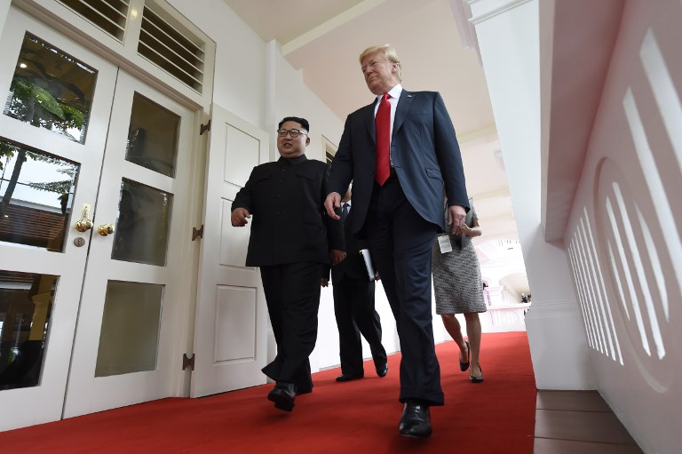 HISTORIC. North Korea's leader Kim Jong-un (L) walks with US President Donald Trump (R) at the start of their historic US-North Korea summit, at the Capella Hotel on Sentosa island in Singapore on June 12, 2018. File photo by Saul Loeb/AFP