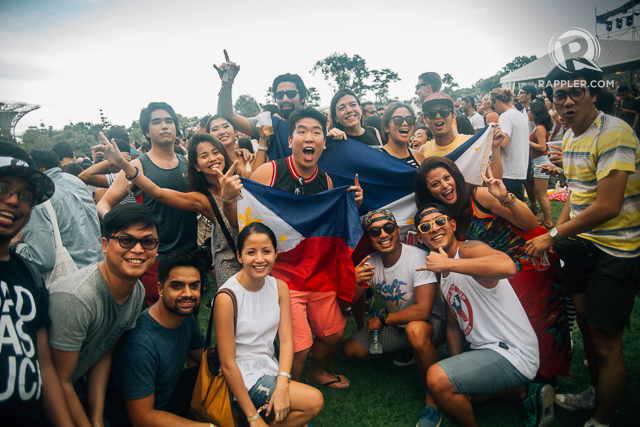 PINOY PRIDE. These Filipino festivalgoers proudly display the Philippine flag.