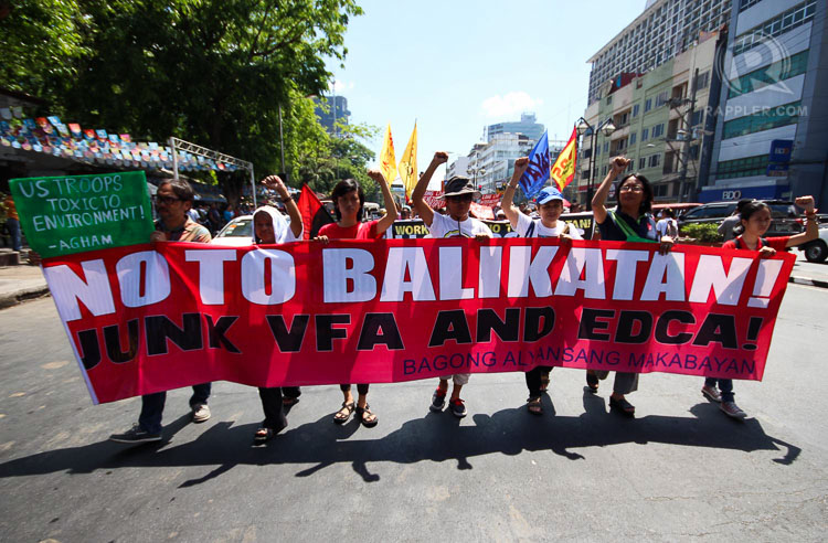 PROTESTS: Members of the Kilusang Mayo Uno march to US Embassy in Manila Monday, to condemn the 31st edition of the Balikatan Exercise between US and Filipino troops which is set to start on April 20, 2015. Photo by Joel Leporada/Rappler