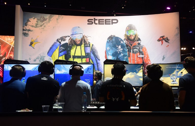 THRILLING ADVENTURES. People play 'Steep' by Ubisoft at the Los Angeles Convention Center during the 2016 Electronic Entertainment Expo (E3) in Los Angeles, California on June 14, 2016. Photo by Frederic J. Brown/AFP