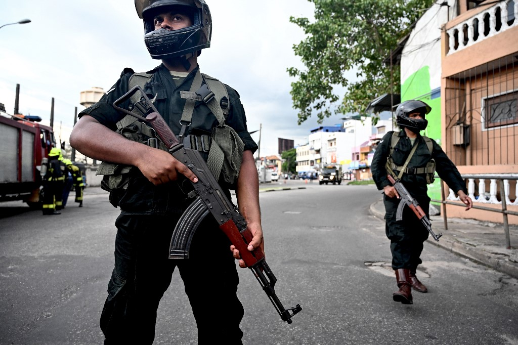 SRI LANKA. Sri Lankan soldiers secure an area near St. Anthony's Shrine after a car explosion in Colombo on April 22, 2019, a day after the series of bomb blasts targeting churches and luxury hotels in Sri Lanka. File photo by Jewel Samad/AFP