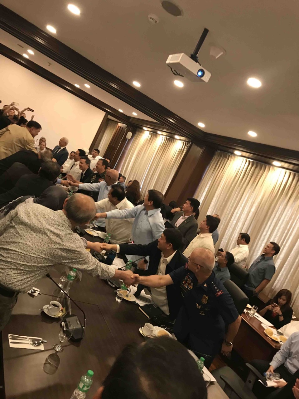 HANDSHAKE. Lawmakers, government officials, and Bangsamoro Transition Commission members shake hands after their meeting.