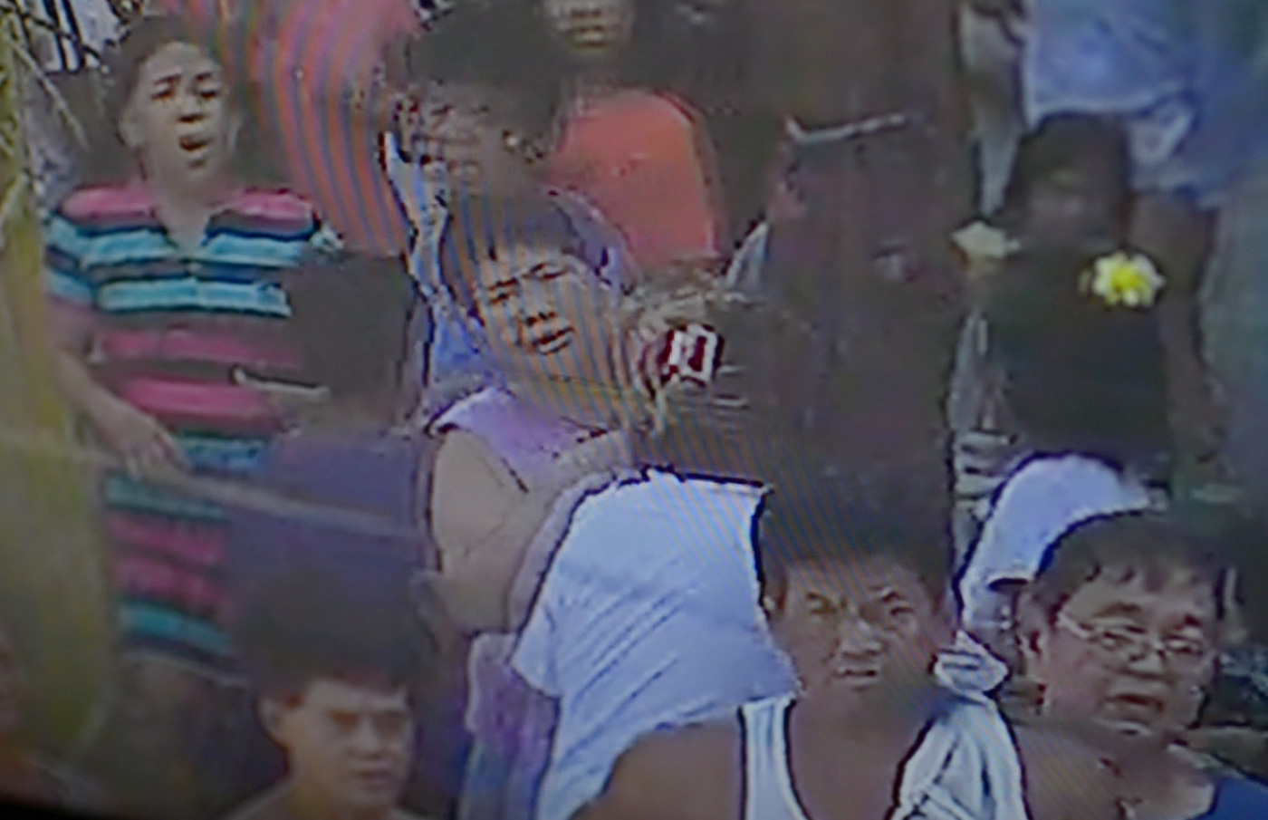 CHAOS. Rosana Brondial is caught in the barangay CCTV, after seeing her 13-year-old son Jayross sprawled on the street. Itu2019s not even a year since she lost an older son. Screen grab from the CCTV of Barangay 103, Pasay City.