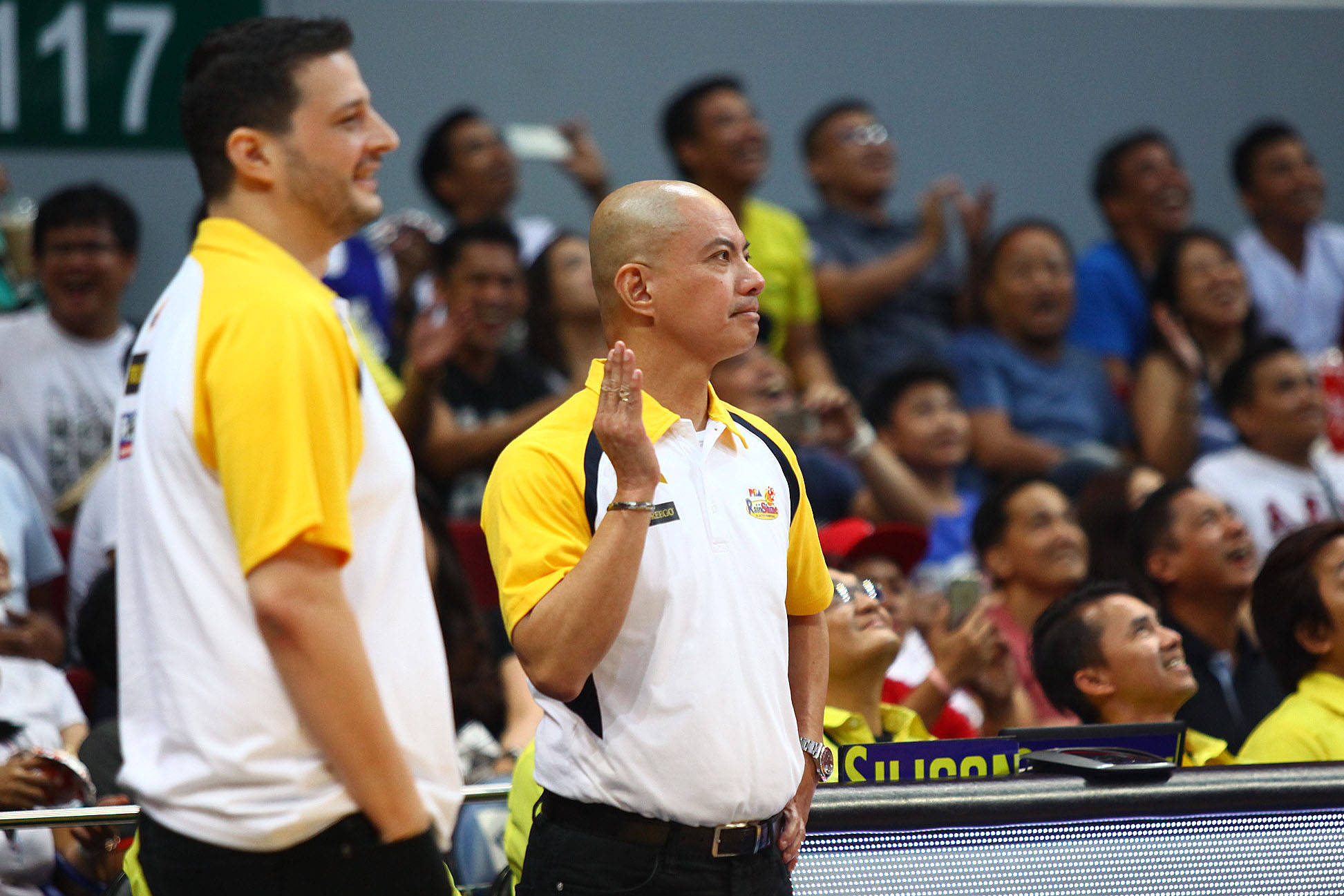 PABEBE WAVE. Rain or Shine coach Yeng Guiao sparks laughter as he did the popular u0022pabebe waveu0022 after the scuffle with Chris Ross. The hand gesture was made popular by the u0022AlDubu0022 love team. Photo by Josh Albelda/Rappler
