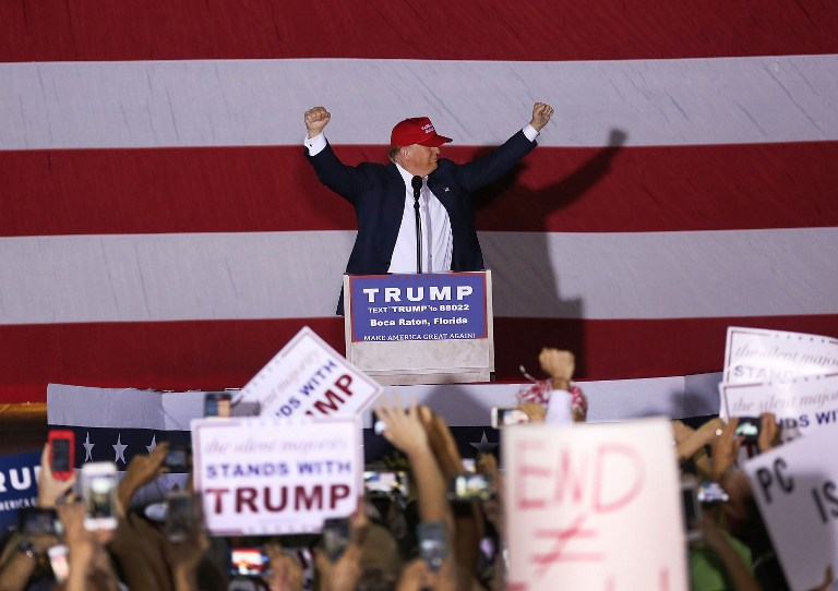 In this file photo, Republican presidential candidate Donald Trump speaks during his campaign rally at the Sunset Cove Amphitheater on March 13, 2016 in Boca Raton, Florida. Joe Raedle/Getty Images/AFP