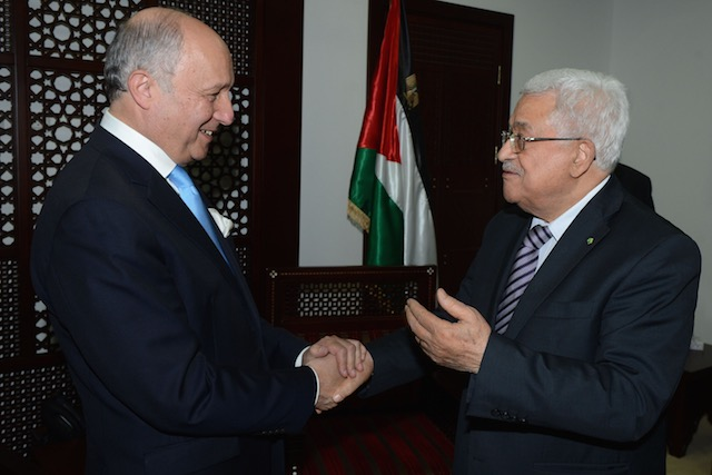 TALKING PEACE. A handout photograph supplied by the Palestinian Authority shows French Foreign Minister Laurent Fabius (L) as he is greeted by Palestinian President Mahmoud Abbas (R), in the 'Muqata' or Palestinian Authority headquarters, in the West Bank town of Ramallah, June 21, 2015. Thaer Ganaim/EPA