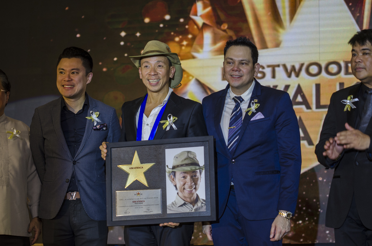 Kim Atienza holds his plaque of recognition after unveiling his star at Eastwood City.