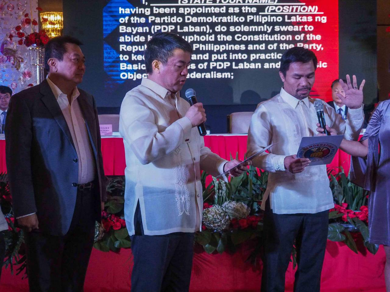 ALLIES. PDP President Koko Pimentel swears in Senator Manny Pacquiao as PDP regional president for Region 12, witnessed by PDP Secretary General Pantaleon Alvarez. Photo courtesy of House of Representatives Media Bureau