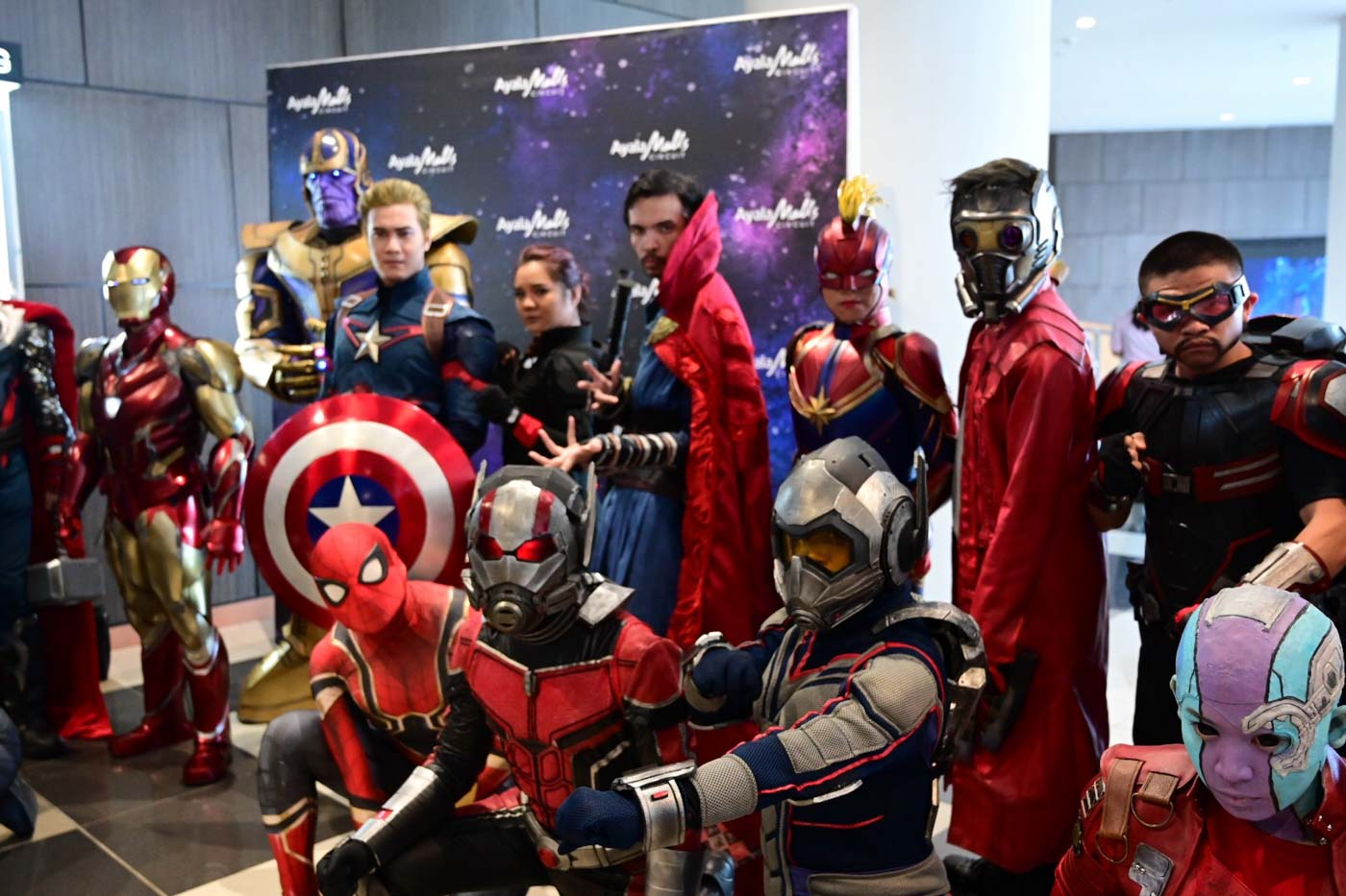 ASSEMBLE. Cosplayers pose for photos before the movie.