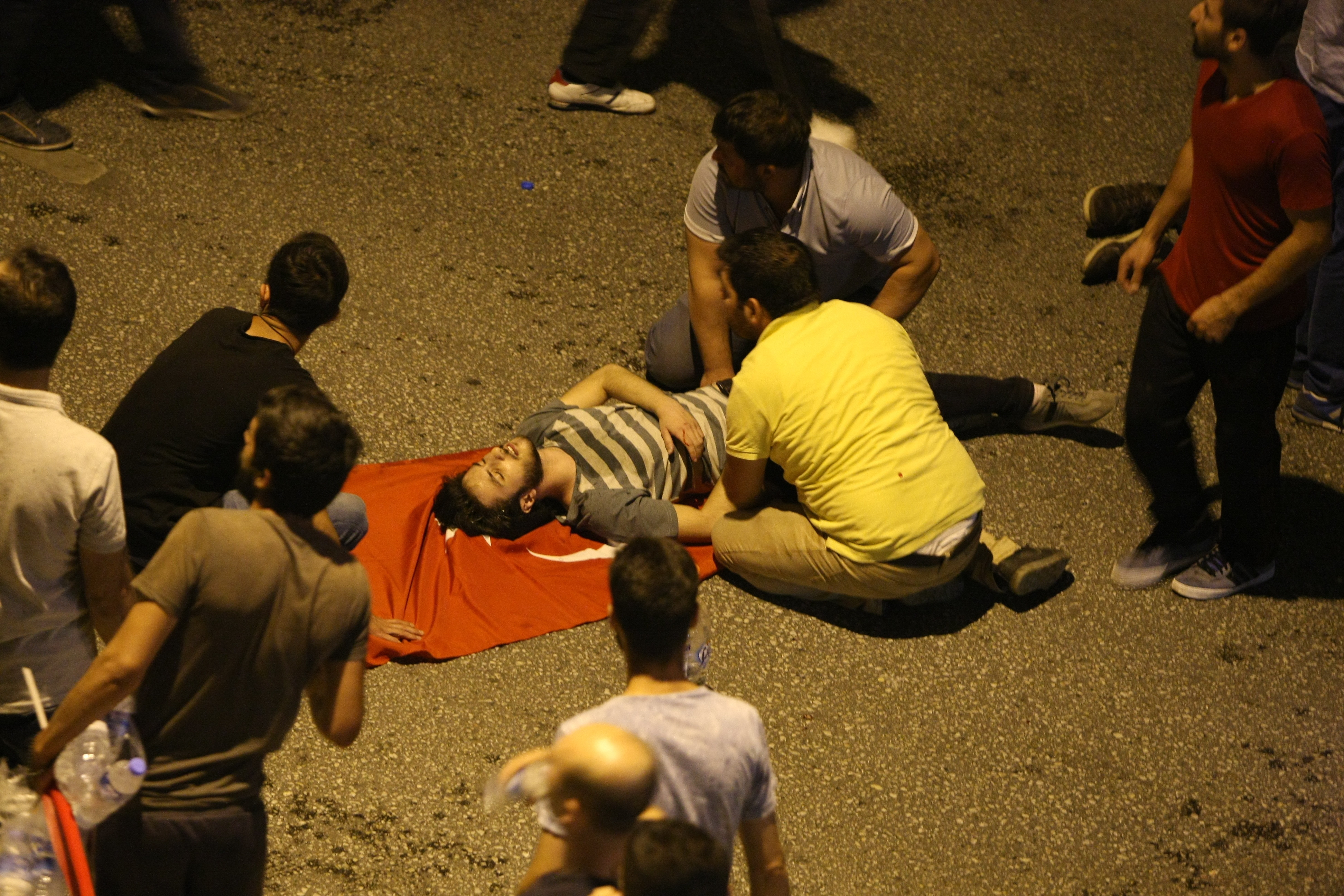 FIRST AID. People attend to a wounded person in Ankara. Photo by EPA