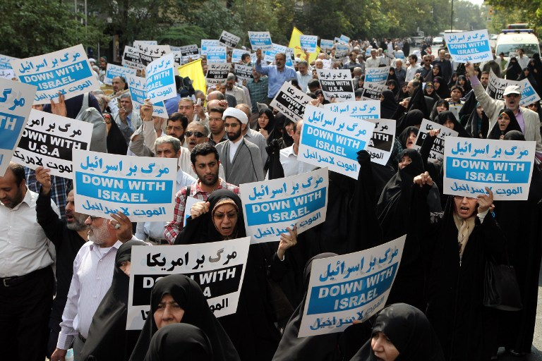 Iranian protestors hold an anti-Israeli banners during a demonstration in defense of the Al-Aqsa mosque, Islamu2019s third holiest site, located in Jerusalem's old city on September 18, 2015 after the weekly Friday prayers at Palestine square in Tehran. Photo by AFP