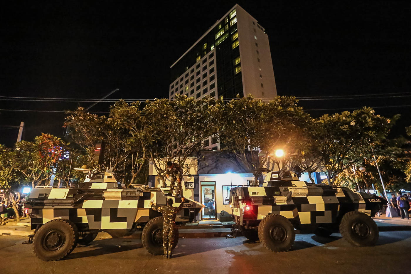 JOINT FORCES. PSG armored personnel carriers guard the Marco Polo Hotel.