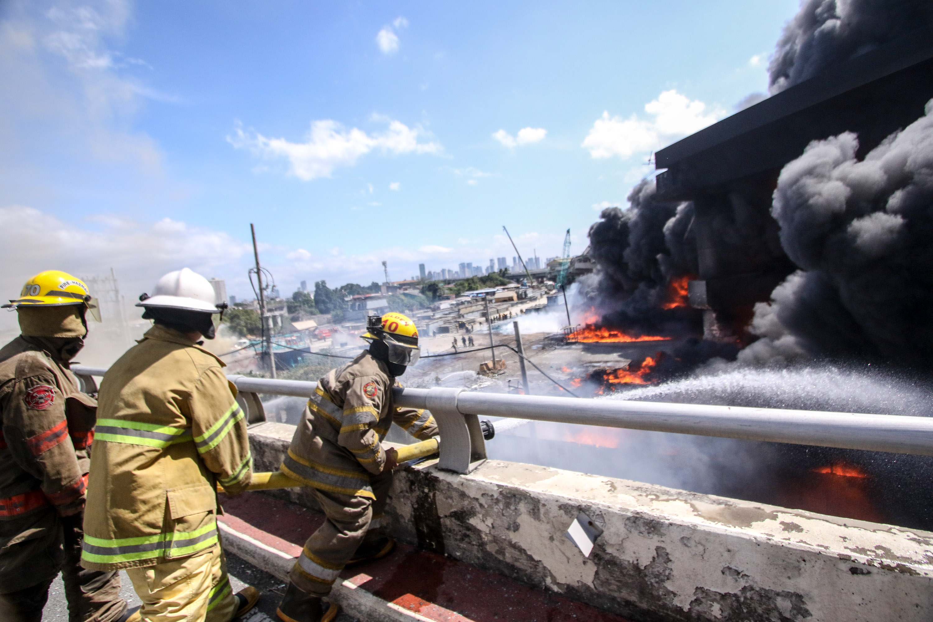 FIREFIGHTERS. Firemen try to put out the fire that extended to a portion of the Metro Skyway Stage 3 in Pandacan, Manila, on February 1, 2020. Photo by KD Madrilejos/Rappker
