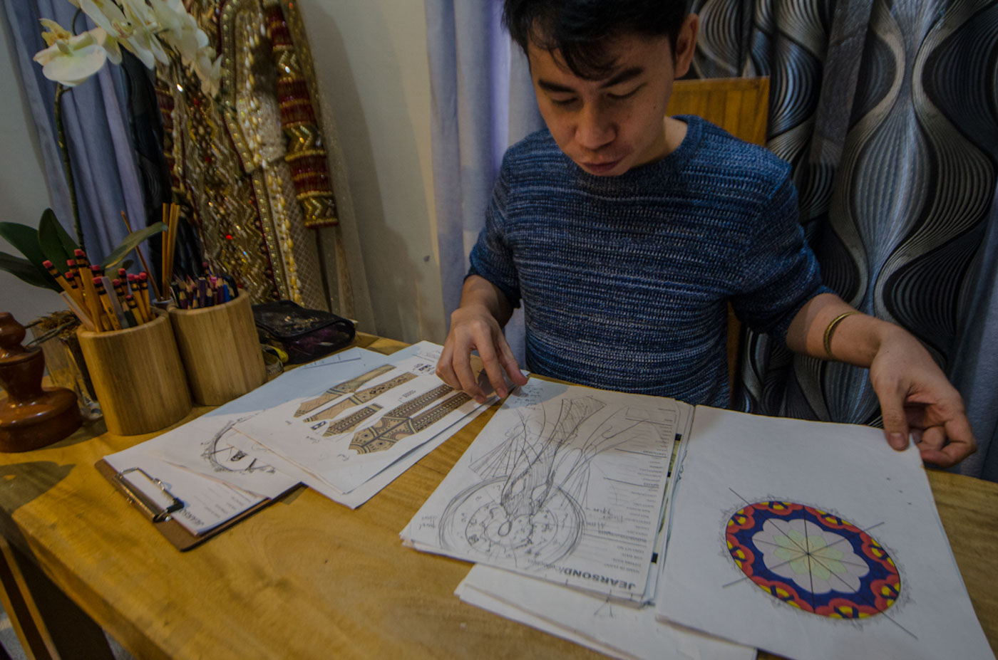 THE MAKING. Jearson shows the sketches of the national costume which he, Catriona and the team worked on.