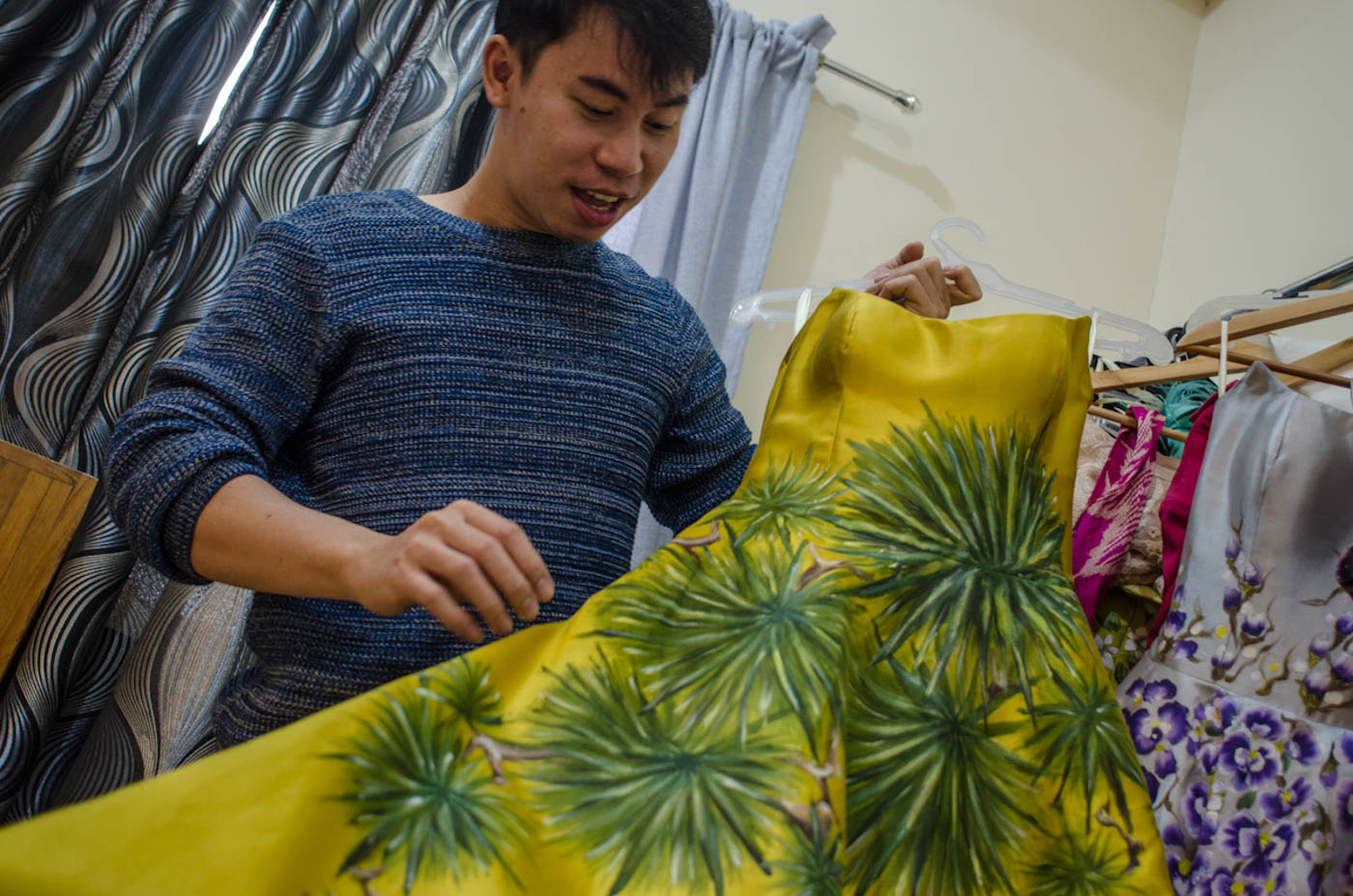 STANDOUT. Jearson holds the dress Catriona wore during one of the rehearsals for Miss Universe.