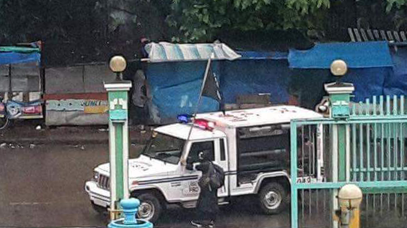 POLICE CAR? Another ISIS black flag is seen atop what appears to be a police car taken by the Maute Group. Photo by Chico Dimaro Usman