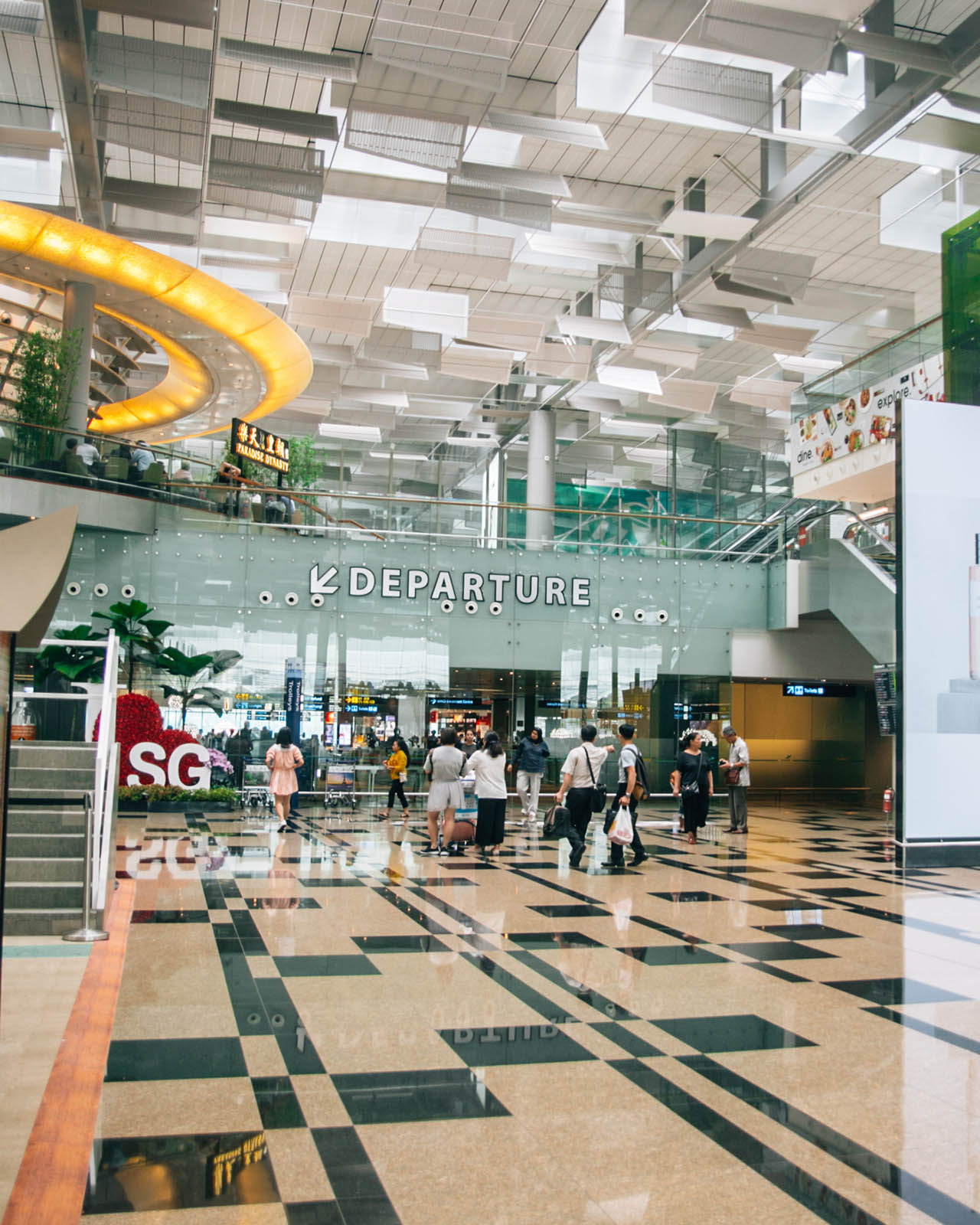 GATEWAY TO SINGAPORE. Rachel Chu and Nick Young enter Singapore through the award-winning Changi Airport. Pictured is the departure hall of Terminal 3. Photo by Paolo Abad/Rappler