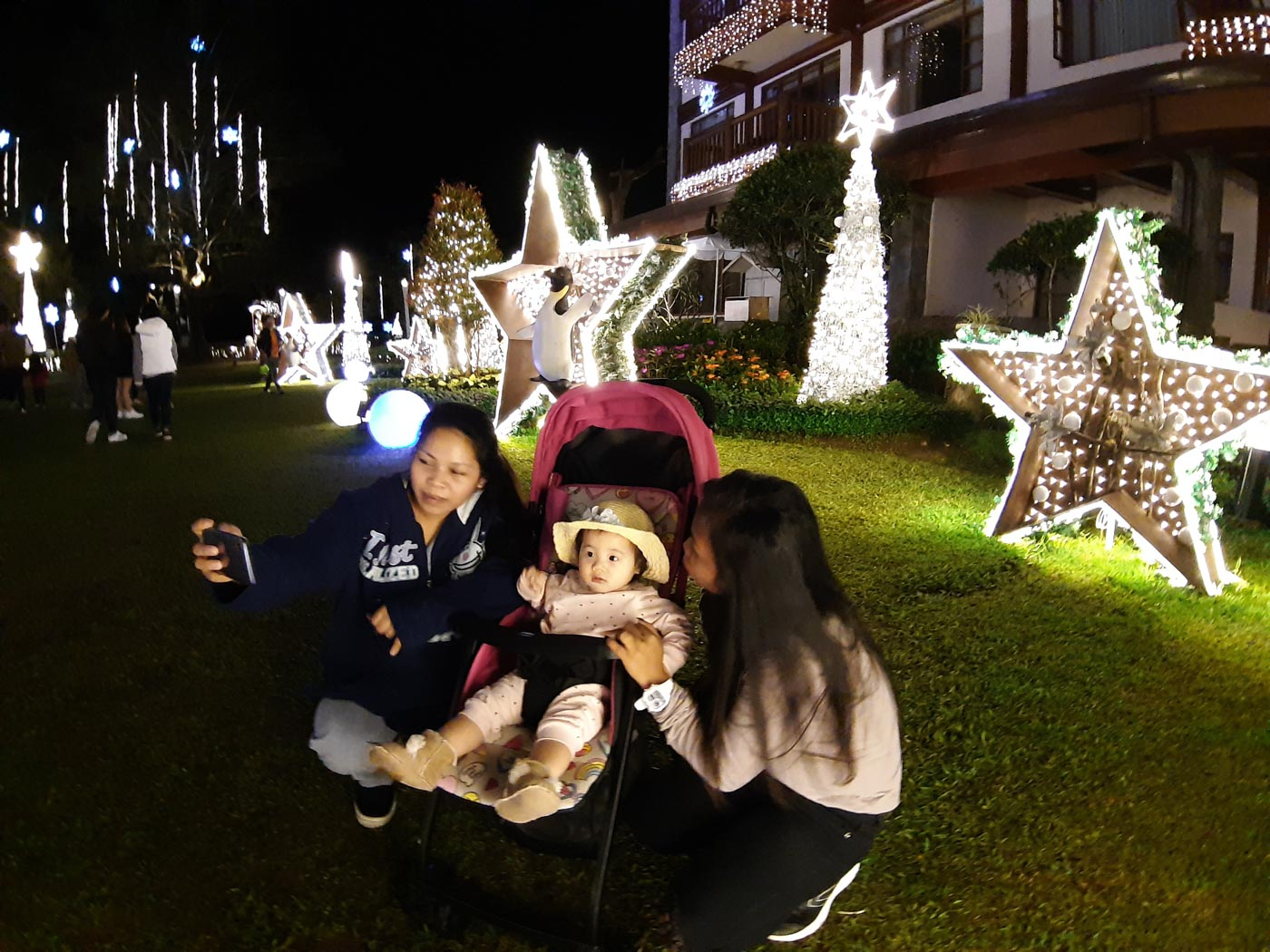 PHOTO TIME.  A family takes a selfie at the Camp John Hay Manor Hotel as they light their Christmas decorations and tree in Baguio. Photo by Mau Victa/Rappler