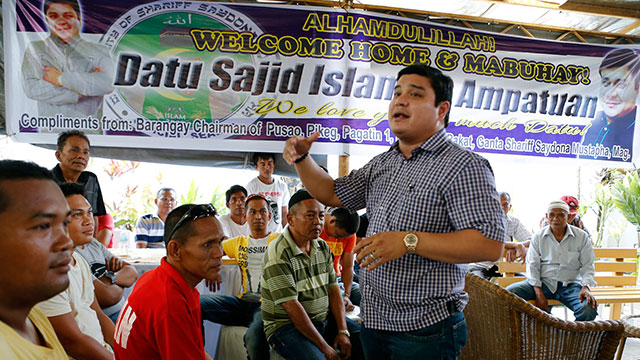 BAIL. Sajid Islam Ampatuan, son of former Maguindanao governor Andal Ampatuan Sr (extreme right) who was granted bail on January this year, speaks to their family's supporters upon his return to Cotabato City, May 10, 2015, after 5 years in prison.