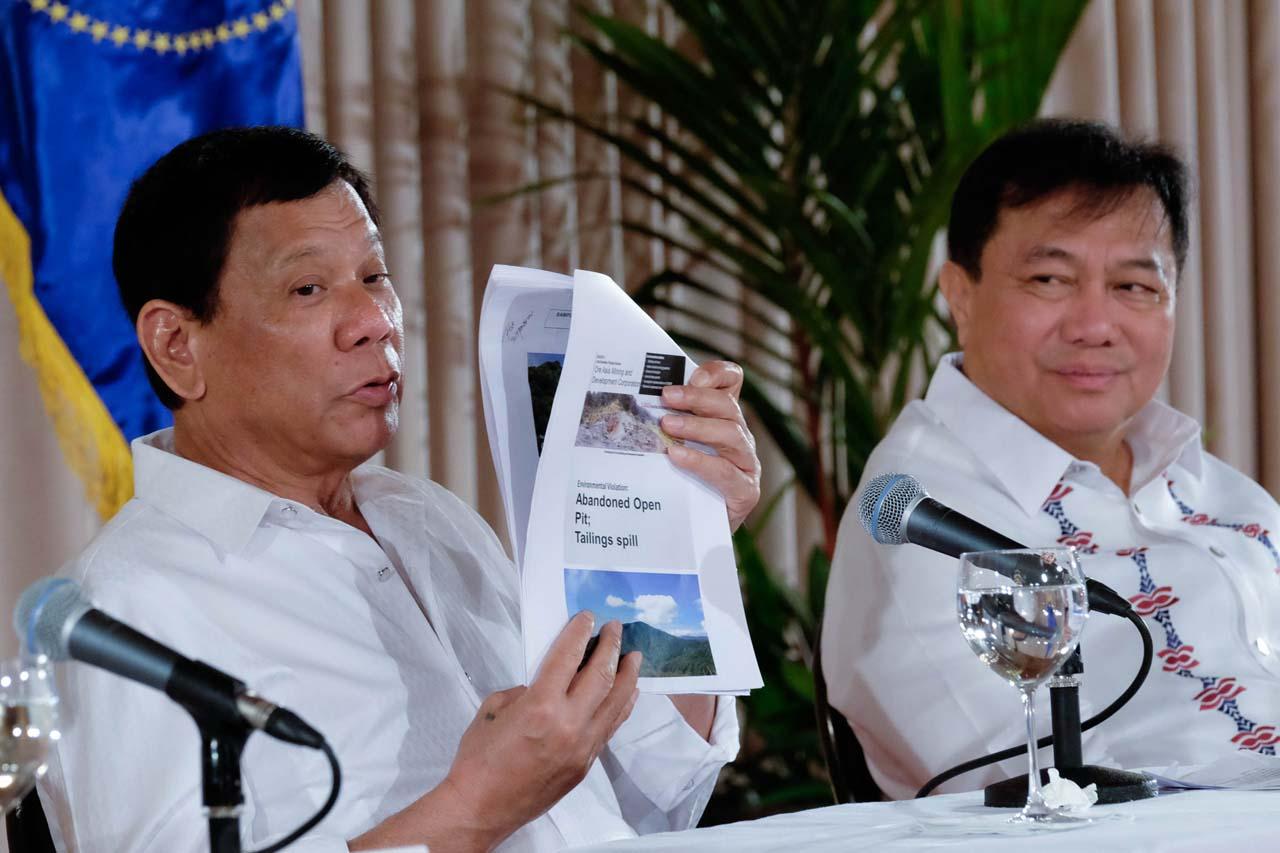 DUTERTE'S LONGTIME FRIEND. Speaker Pantaleon Alvarez looks on as President Rodrigo Duterte shows a document during a press conference in Malacau00f1ang March 13, 2017. Photo by Rene Lumawag/Presidential Photo