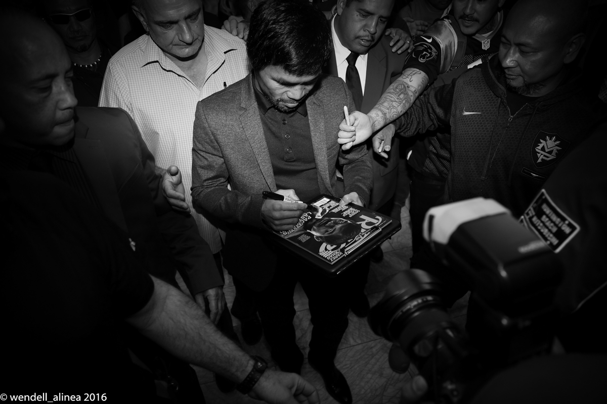 Manny Pacquiao signs a copy of The Ring magazine for a fan. Photo by Wendell Alinea