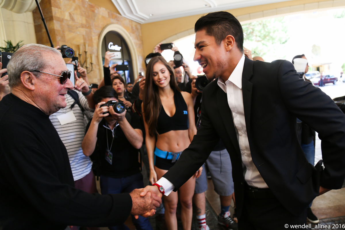 WBO junior welterweight champ Jessie Vargas shakes hands with promoter Bob Arum. Photo by Wendell Alinea
