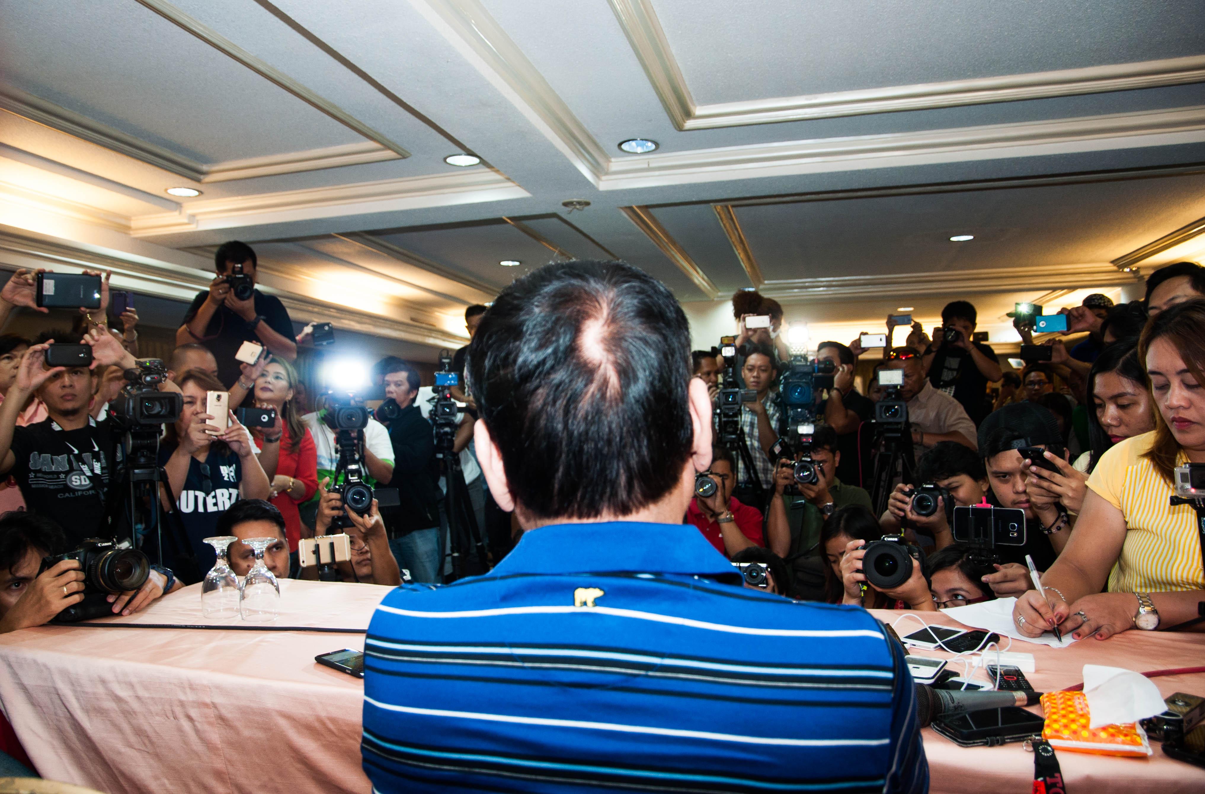 'I'M SORRY.' Rodrigo Duterte tells a stunned crowd that he won't be running for president in 2016. Photo by Edwin Espejo/Rappler
