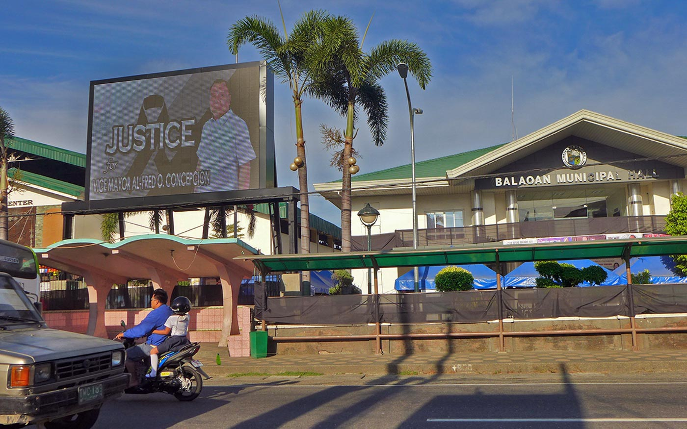 REMINDER. Another poster just outside the Balaoan Municipal Hall with the image of the late Vice Mayor Al-fred Concepcion