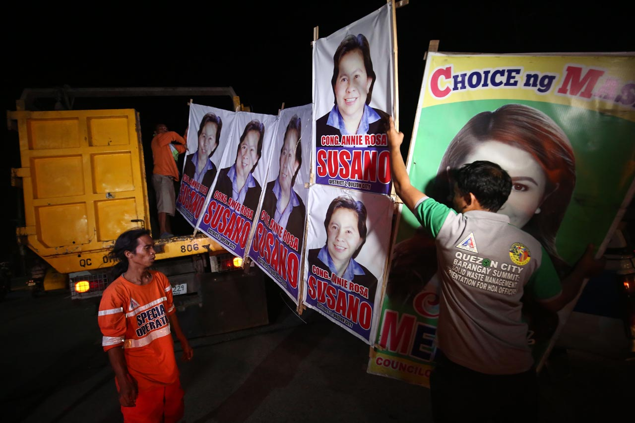 TAKE DOWN. Local government workers start early to remove illegal campaign posters all over Quezon City during their Task Force Tear Down on Friday, March 1, 2019. Photo by Ben Nabong/Rappler