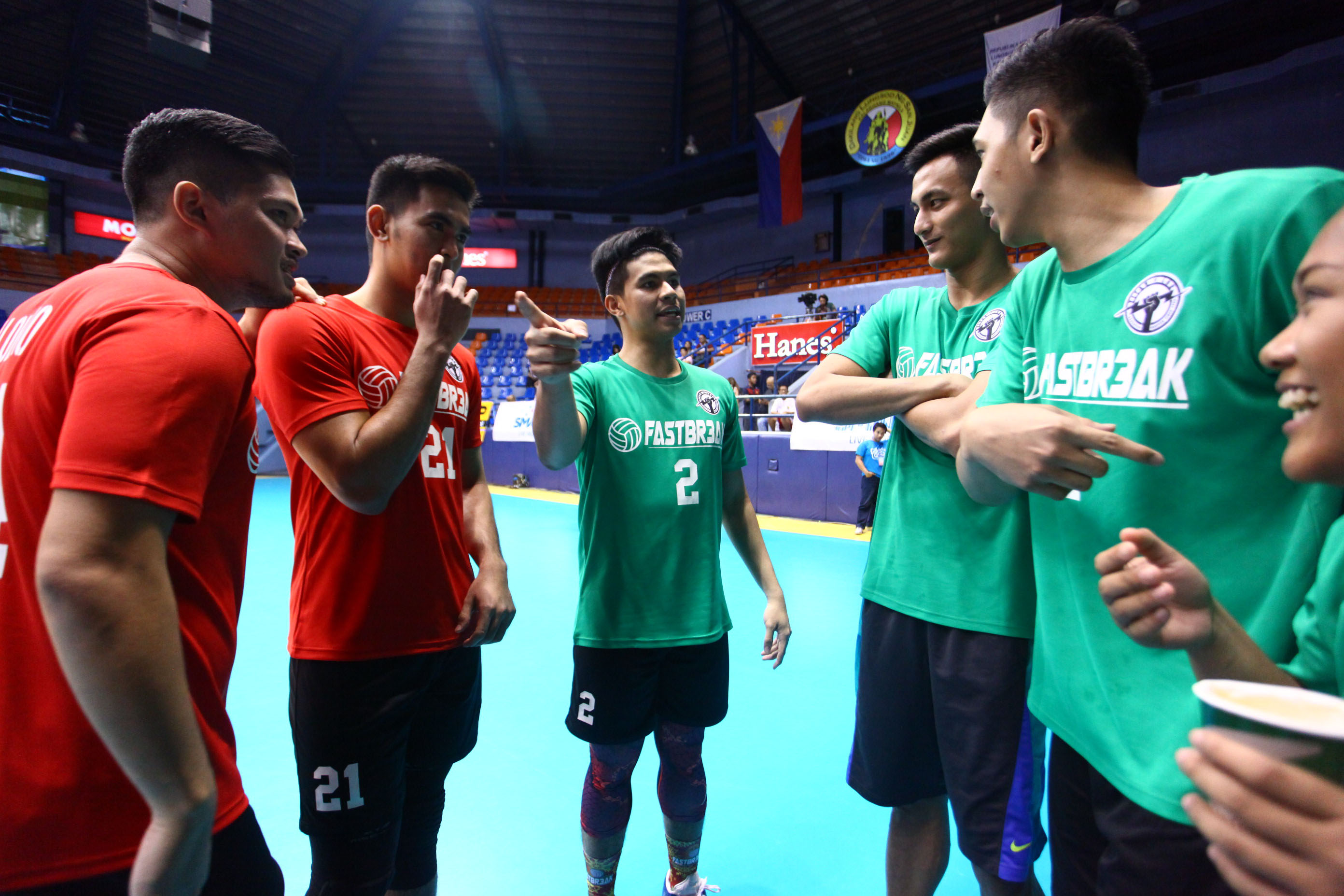 DIFFERENT SPORT. UAAP basketball players game plan during the volleyball game. Photo by Josh Albelda/Rappler
