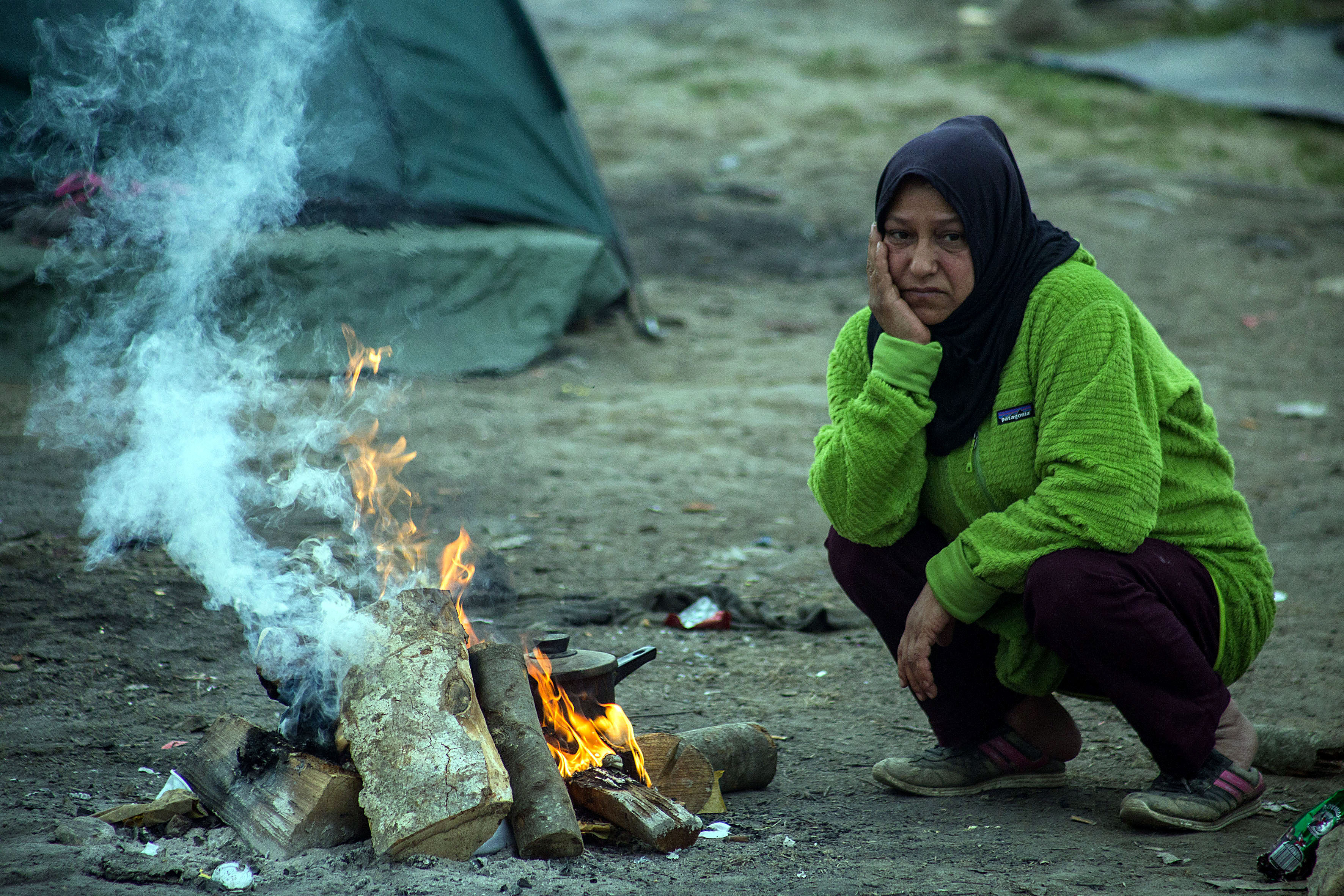 DIRE CONDITIONS. A refugee from Syria sits outside her tent in the makeshift camp in Idomeni, Greece, on March 23, 2016. File photo by Nikos Arvanitidis/EPA