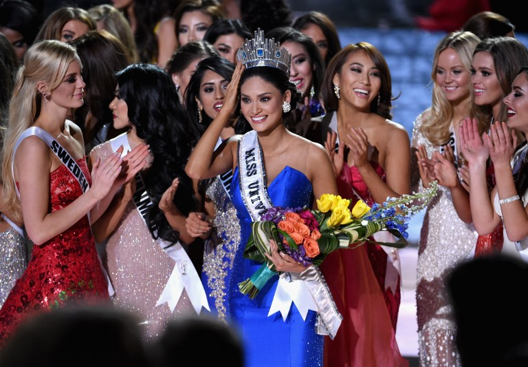 CROWNED. Pia Alonzo Wurtzbach (C), who was mistakenly named as First Runner-up reacts with other contestants after being named the 2015 Miss Universe during the 2015 Miss Universe Pageant at The Axis at Planet Hollywood Resort u0026 Casino on December 20, 2015 in Las Vegas, Nevada. Photo by Ethan Miller/Getty Images/AFP