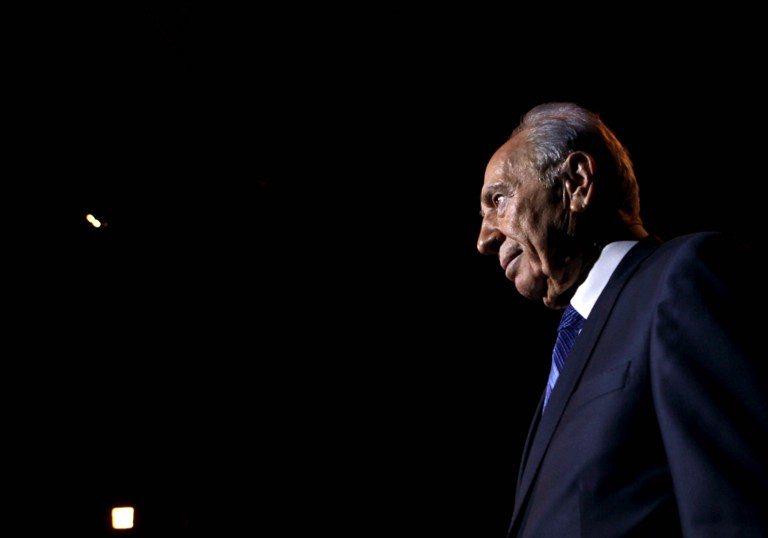 Israeli President Shimon Peres gets off the stage after delivering a speech during the 'Facing Tomorrow' Conference. This is the second annual global conference hosted by Peres on October 20, 2009 in Jerusalem. AFP PHOTO/GALI TIBBON/POOL / AFP PHOTO / GALI TIBBON