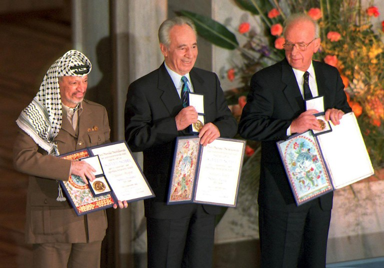 STATESMEN. A picture dated 10 December 1994 of (from left) Palestinian leader Yasser Arafat, then Israeli Foreign Minister Shimon Peres, and late Israeli Prime Minister Yitzhak Rabin as they pose with the Nobel Peace Prize, which they were awarded in the Oslo City Hall. Erik Johansen/Scanpix/AFP