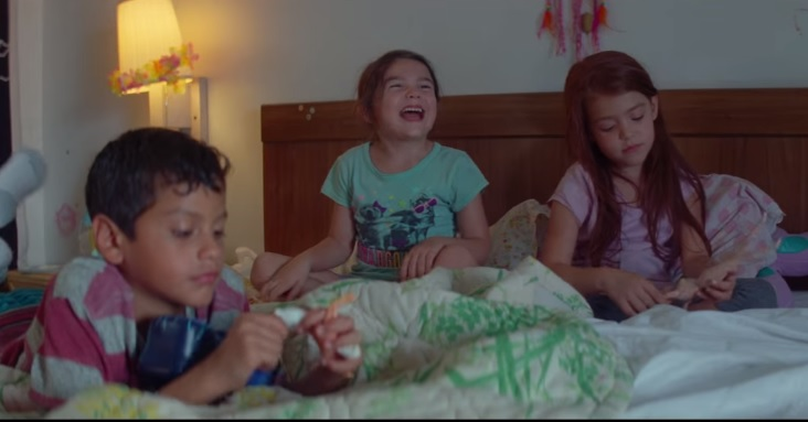 FUN TIME. Moonie (Brooklynn Prince) has fun with her friends in the hotel room.