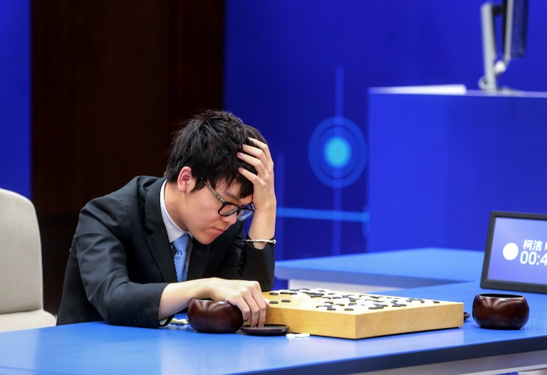 ALPHAGO WINS. China's 19-year-old Go player Ke Jie reacts during the second match against Google's artificial intelligence program AlphaGo in Wuzhen, eastern China's Zhejiang province on May 25, 2017.  Photo by AFP