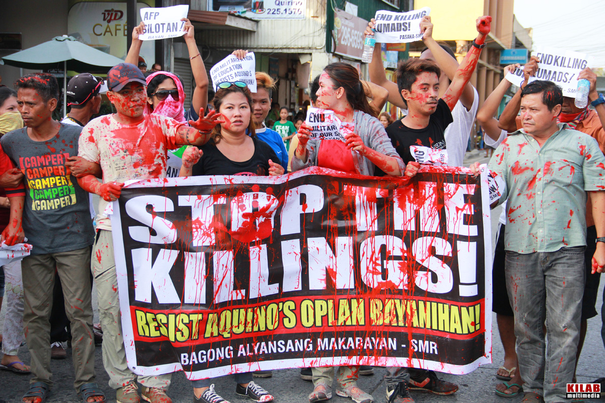 'STOP THE KILLINGS.' Protesters march in Davao City in September 2015, demanding that President Benigno Aquino III order the pullout of military and paramilitary groups from Lumad communities. File photo by Kilab Multimedia