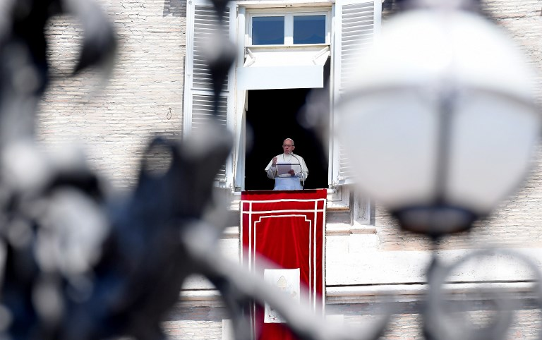 POPE FRANCIS. Pope Francis addresses the crowd from the window of the apostolic palace overlooking Saint Peter's square during his Sunday Angelus prayer on July 29, 2018 at the Vatican. Photo by TIZIANA Fabi/AFP
