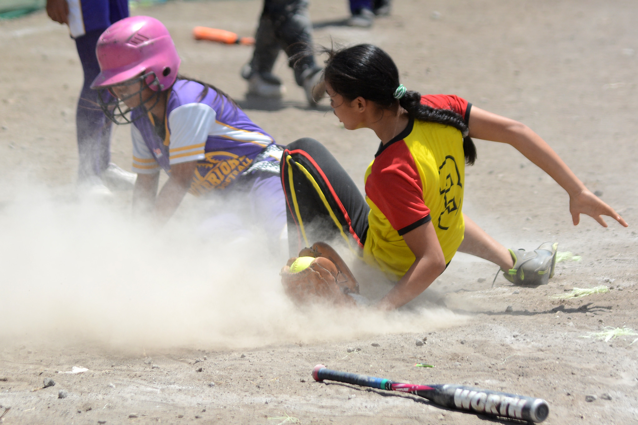 SAFE OR OUT? In this elementary softball match, Soccsksargen wins over Caraga. Photo by Roy Secretario/Rappler