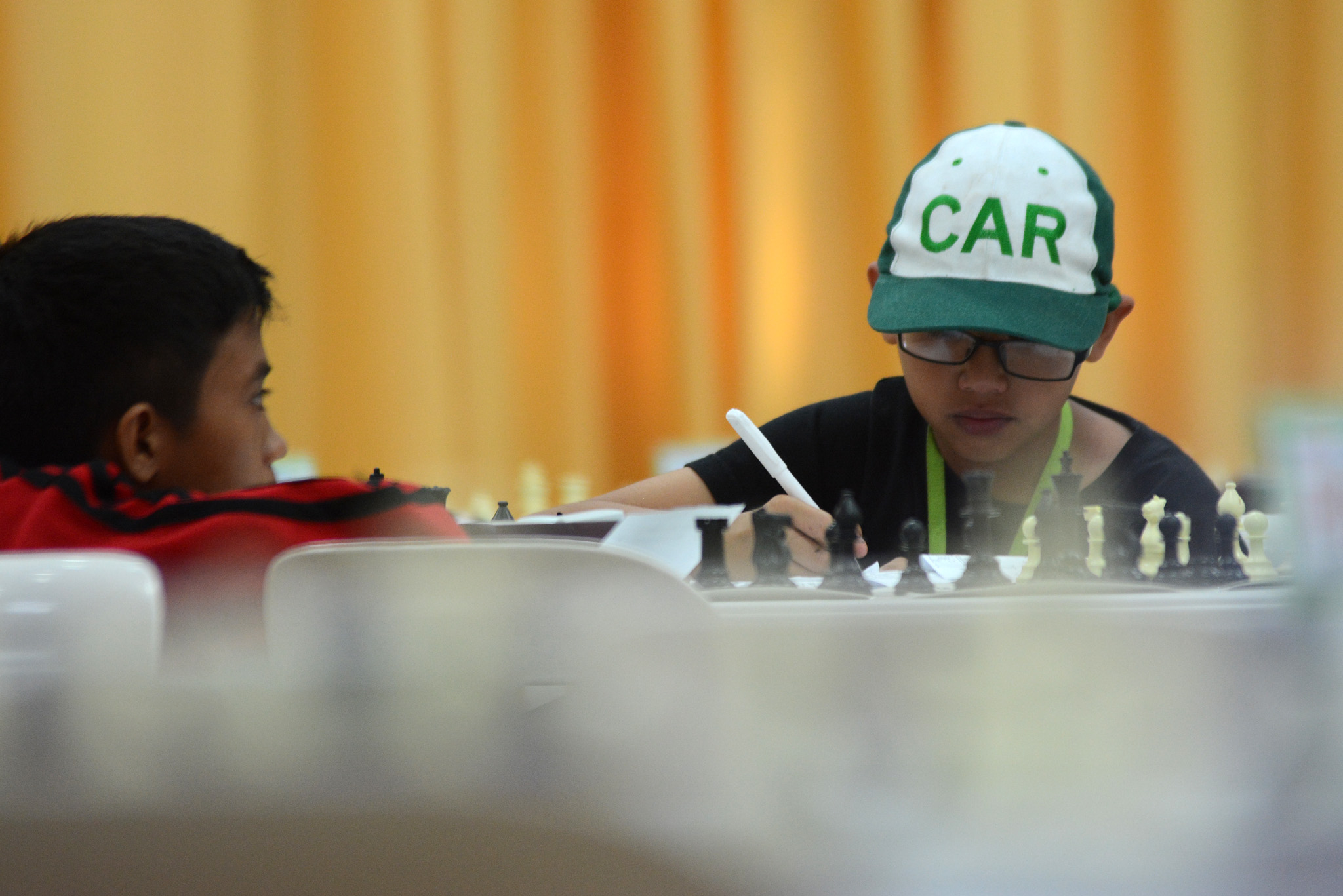 SERIOUS. A CAR athlete has his game face on during a chess match. Photo by Roy Secretario/Rappler