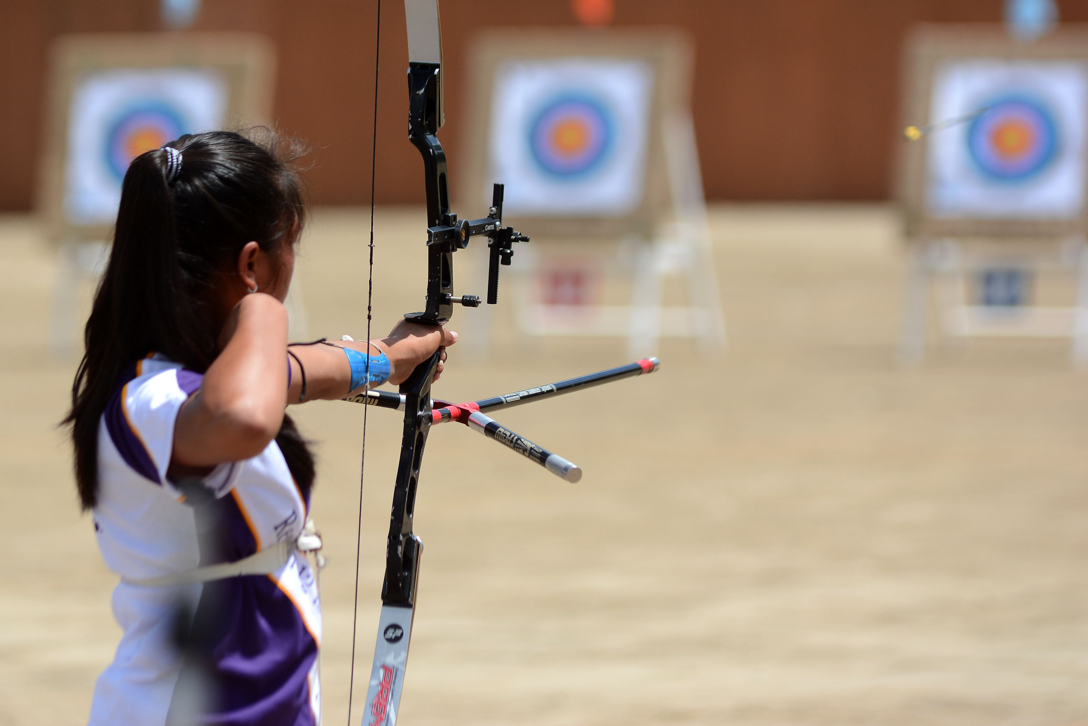 RELEASE. An archer releases her arrow in competition. Photo by Roy Secretario/ Rappler