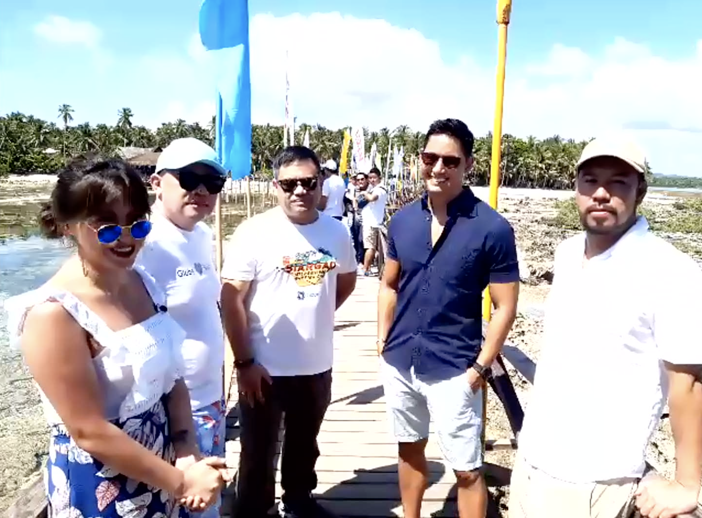 GLOBE-SIARGAO SUSTAINABILE TOURISM WEEK. Francisco Jose u0022Bingou0022 Matugas II of Surigao del Norte, 1st District (center) and Siargao Tourism Operators Association (STOA) President Ian Sermonia (right) join Globe President and CEO Ernest Cu (2nd from left) at the celebration of Globe-Siargao Sustainable Tourism Week.  With them are hosts Joyce Pring (left) and Marc Nelson (2nd from right). Photos from Globe