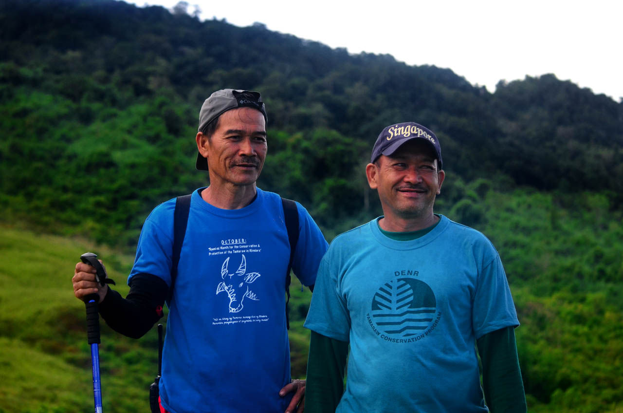 RANGERS. Tamaraw Conservation Program rangers Ed Bata and Ronnie Estrella inside the Iglit-Baco Natural Park. Underfunded and lacking tenure, they nonetheless comprise some of the bravest and most dedicated conservation outdoorsmen in the Philippines. Photo by Gregg Yan/BIOFIN