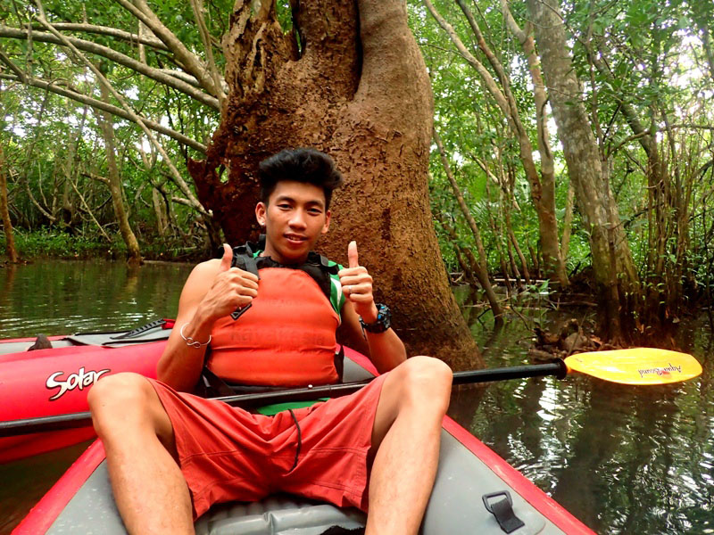 RIVER PROTECTOR. Jeremy Morquiala, 27, is a kayak guide and is also a member of Abatan Riveru2019s local organization working to protect the river and its mangroves. Behind him is one of the riveru2019s century-old mangroves.