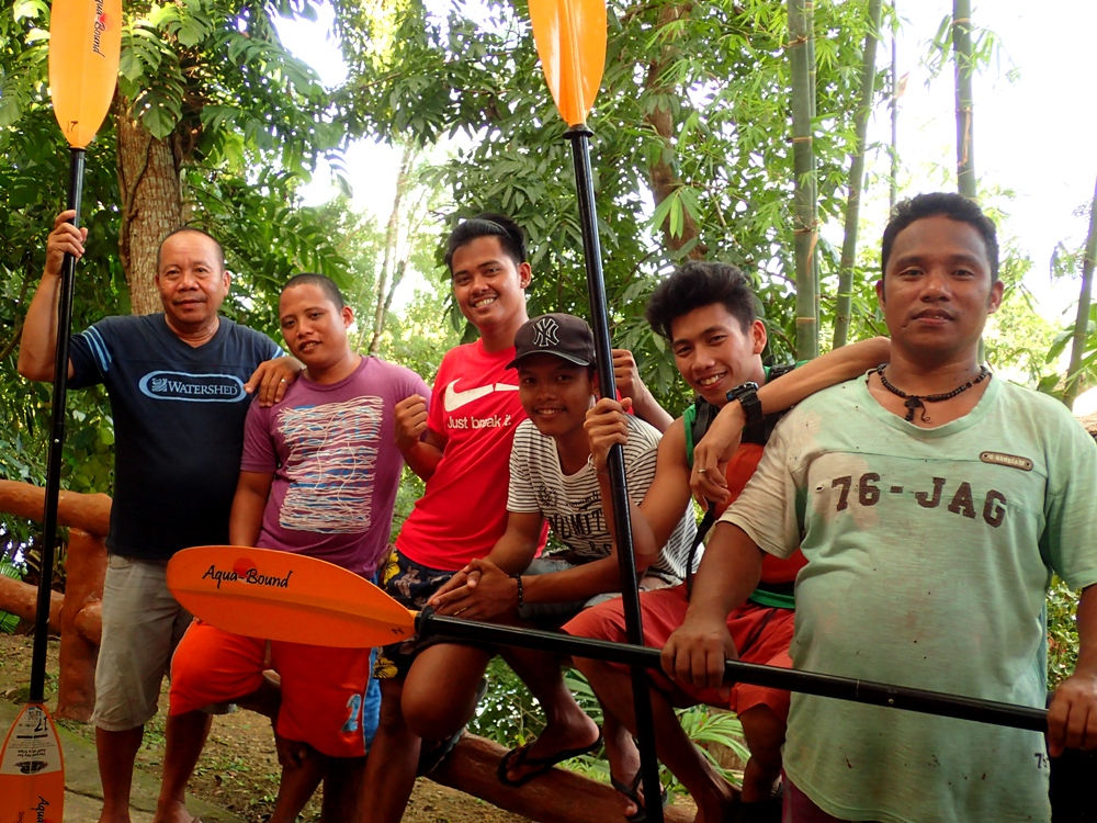 LOCAL COMMUNITY. Some of Abatan Riveru2019s local guides, including the first guide Sam Yolo, who also heads a local organization protecting mangroves