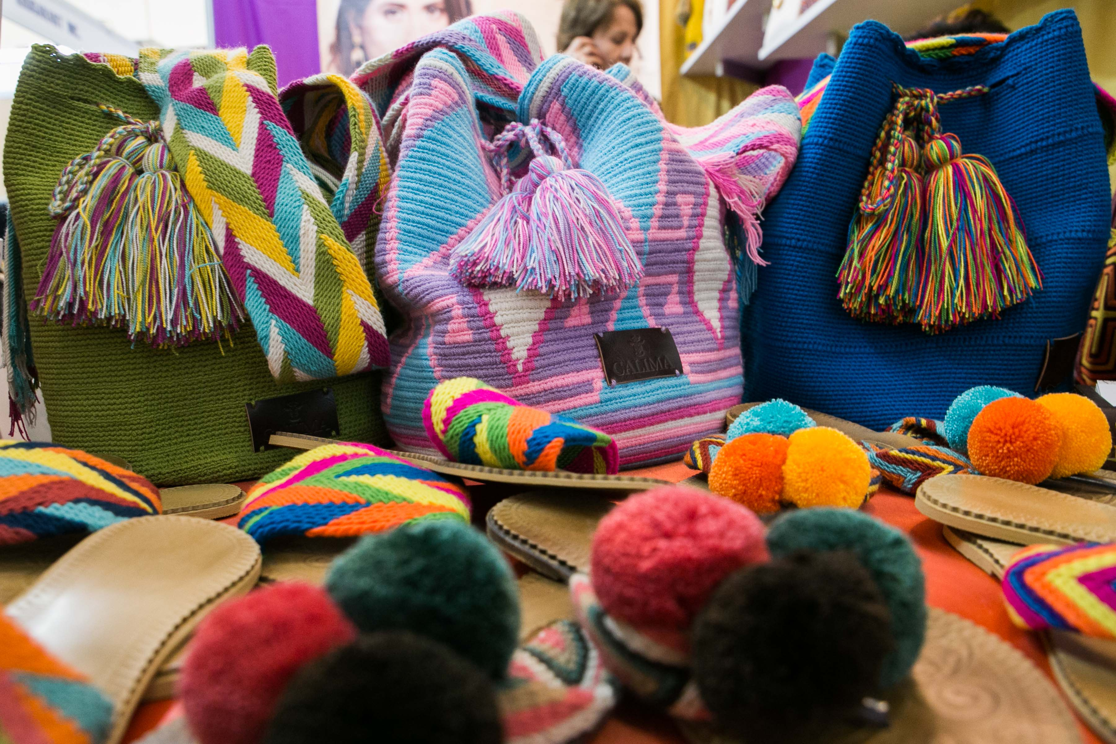 MOCHILA. These bags and sandals were handmade by the Wayuu tribe in Colombia. Parts of Calima's profits go to the community there. According to Hernandez, most of the women there earn money through woven products. Photo by Pat Nabong/Rappler