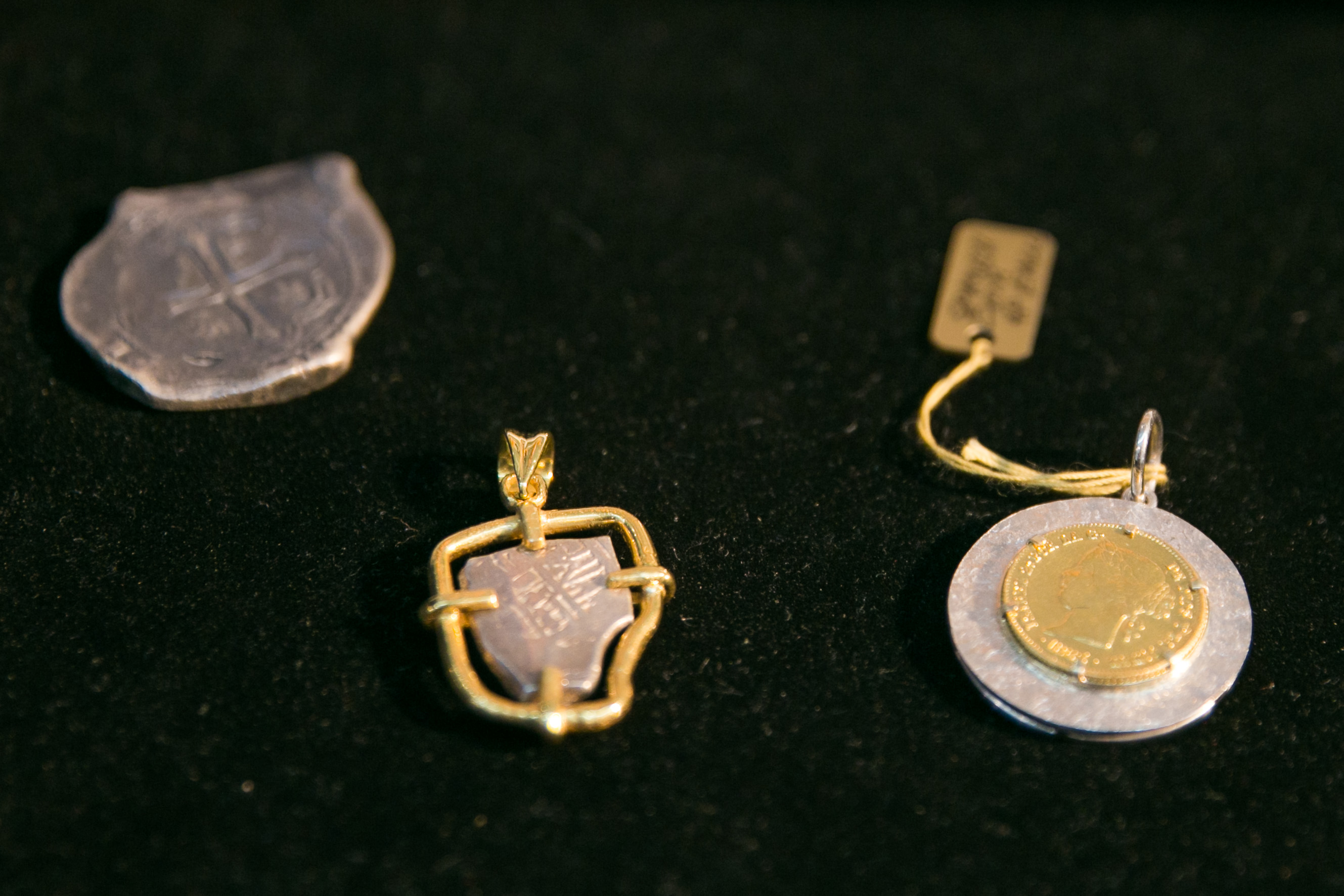ANTIQUE COINS. Hilis Kalamays (left) are coins used during the Galleon Trade. In the center is a hilis kalamay that Maria Angelica turned into a pendant. Photo by Pat Nabong/Rappler