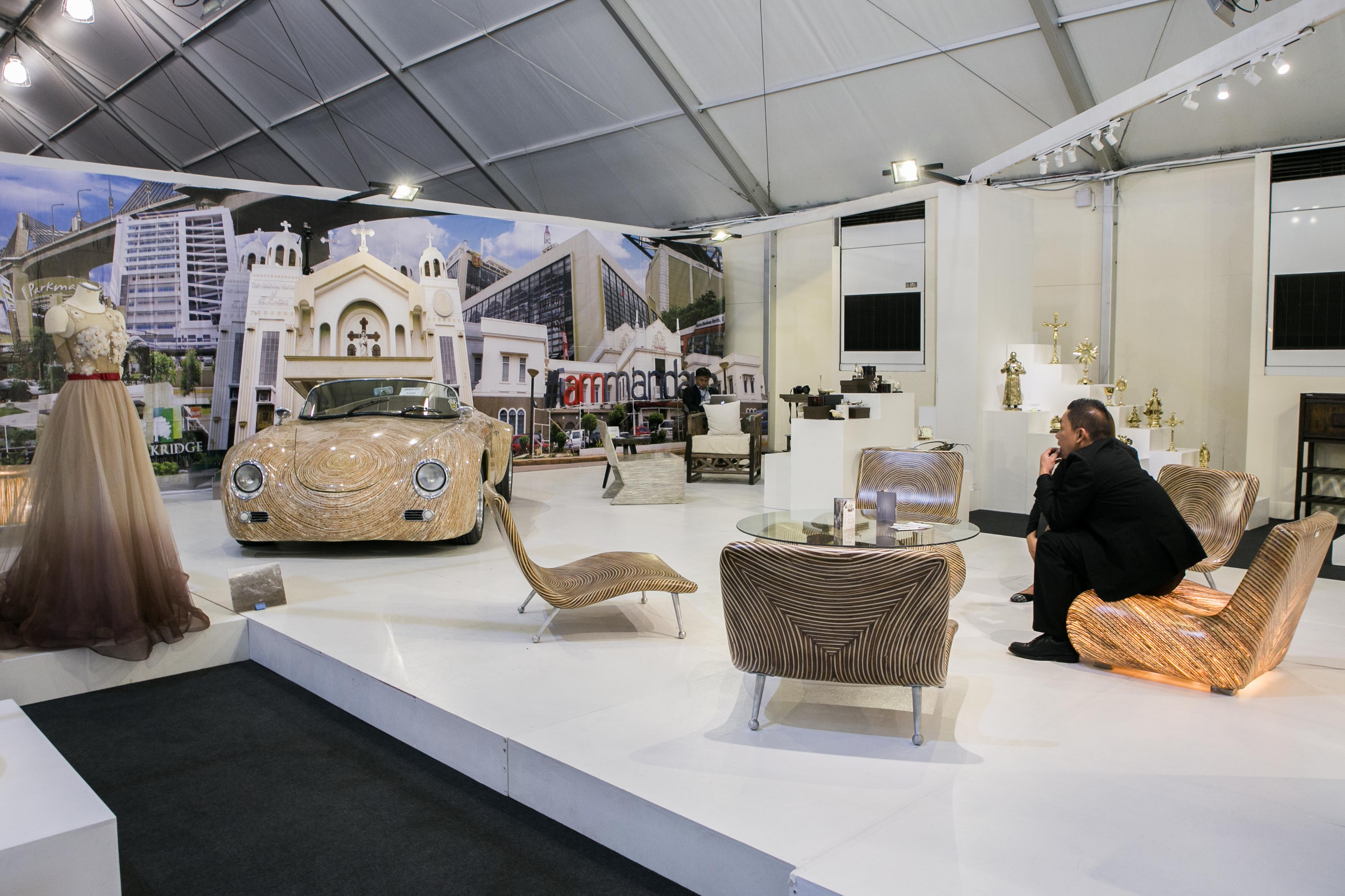 ONE-OF-A-KIND CAR. A 1959 Porsche convertible (not for sale) handmade with coconut twigs and rattan, and encased in fiber glass, is displayed at Expo Mandaue at the APEC-International Media Center. It was designed by Clayton Togonon. Photo by Pat Nabong/Rappler